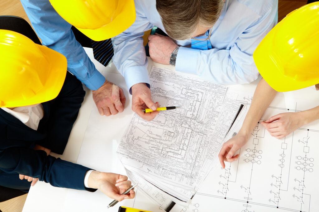 contractors going over plans for flooring